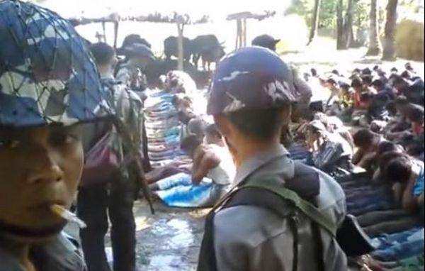 Capture écran d'une vidéo montrant un Rohingya se faire battre par des policiers.