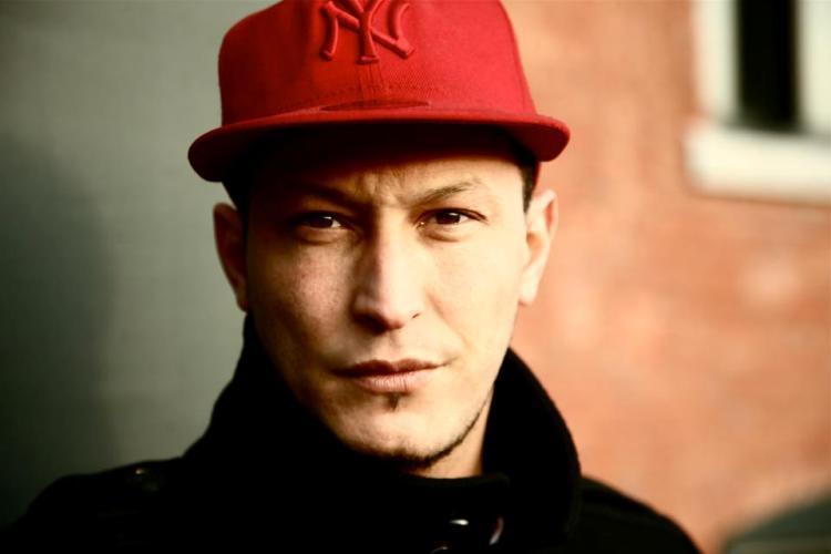 Hicham Kochman aka Axiom, rappeur et militant.