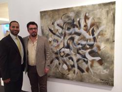 Moustafa Fahour (à gauche) avec Sabah Arbilli, le lauréat du Prix  intenational de galigraphie devant l'une de ses oeuvres.