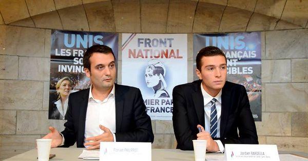 Jordan Bardella (à dr.) aux côtés de Florian Philippot lors d'une réunion publique au Blanc-Mesnil (93)  en 2014.
