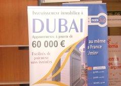 Affiche vantant l'investissement immobilier à Dubaï