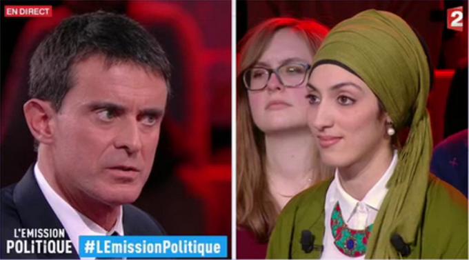 Manuel Valls face à Attika Trabelsi, une féministre musulmane qui a interpellé l'ex-Premier ministre sur la question des discriminations des femmes voilées lors d'un débat dans L'Emission politique sur France 2.