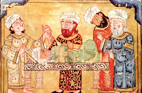 Une miniature arabe représentant des médecins au lit d'un malade.
